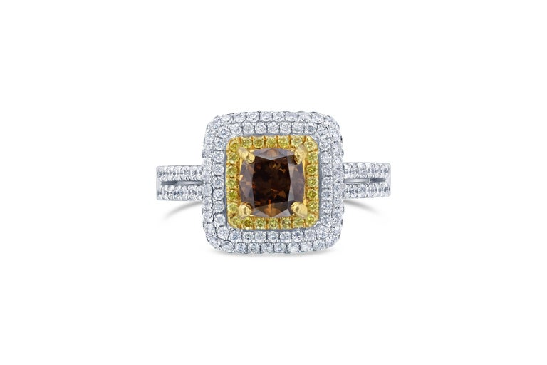 Stunning Stunning Stunning! A gorgeous ring that can be a Promise Ring, Engagement Ring, Cocktail Ring, or a Wedding Ring!  This ring is modernly set with a Triple Halo surrounding the center Natural Brown Cushion Cut Diamond. The center diamond