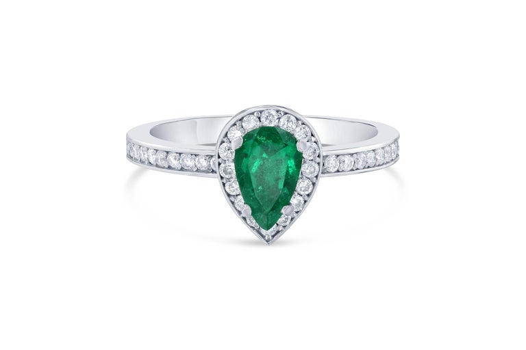 Beautiful, Stunning and Unique! This Pear Cut Emerald Ring will be a gorgeous ring to wear everyday!  The Emerald is 0.56 Carats and is surrounded by a halo of 37 Round Cut Diamonds weighing 0.20 Carats. The total carat weight of the ring is 0.76