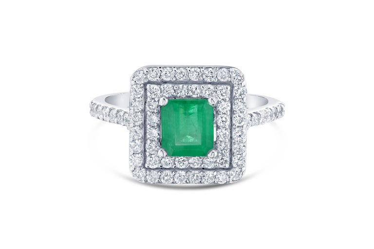 Gorgeous Double Halo Emerald Ring!   This stunning ring can be an everyday Engagement Ring or an everyday ring for the Right Hand!   The Emerald is 1.06 Carats and is surrounded by a double halo of 64 Round Cut Diamonds weighing 0.78 Carats. The