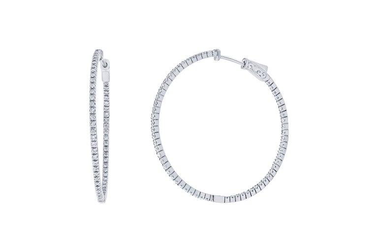 These stunning diamond hoops have diamonds set inside and out to give the piece symmetry and sparkle from all angles.  There are 124 Round Cut Diamonds that weigh 1.07 carats and they are made in 14K White Gold and weigh approximately 6.8 grams.
