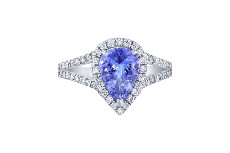 A gorgeous Tanzanite and Diamond ring set in a split shank 14K white gold setting and is approximately 5.3 grams.  The Tanzanite is a Pear cut stone that weighs 1.59 carats.  The ring is surrounded by a halo of 66 Round Brilliant Cut diamonds that