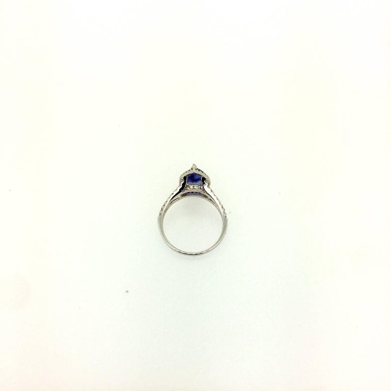 2.04 Carat Tanzanite Diamond Halo Ring In As New Condition For Sale In San Dimas, CA