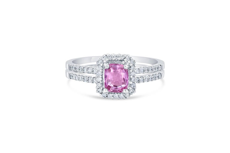 Gorgeous Pink Sapphire Diamond Ring with a beautiful setting! Can be a very unique Engagement Ring or Cocktail Ring! Also has a GIA Certificate #: 2195053396 The center Cushion Cut Pink Sapphire is 0.93 Carats surrounded by a halo and split shank of