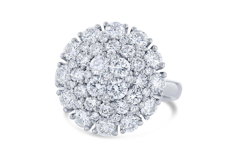 A gorgeous cocktail ring that will fulfill all your desires! A real stunner! Do not miss this unique diamond ring!  It has 45 Round Cut Diamonds that weigh a total of 2.67 Carats. The clarity and color of the diamonds are VS-F.   It is beautifully