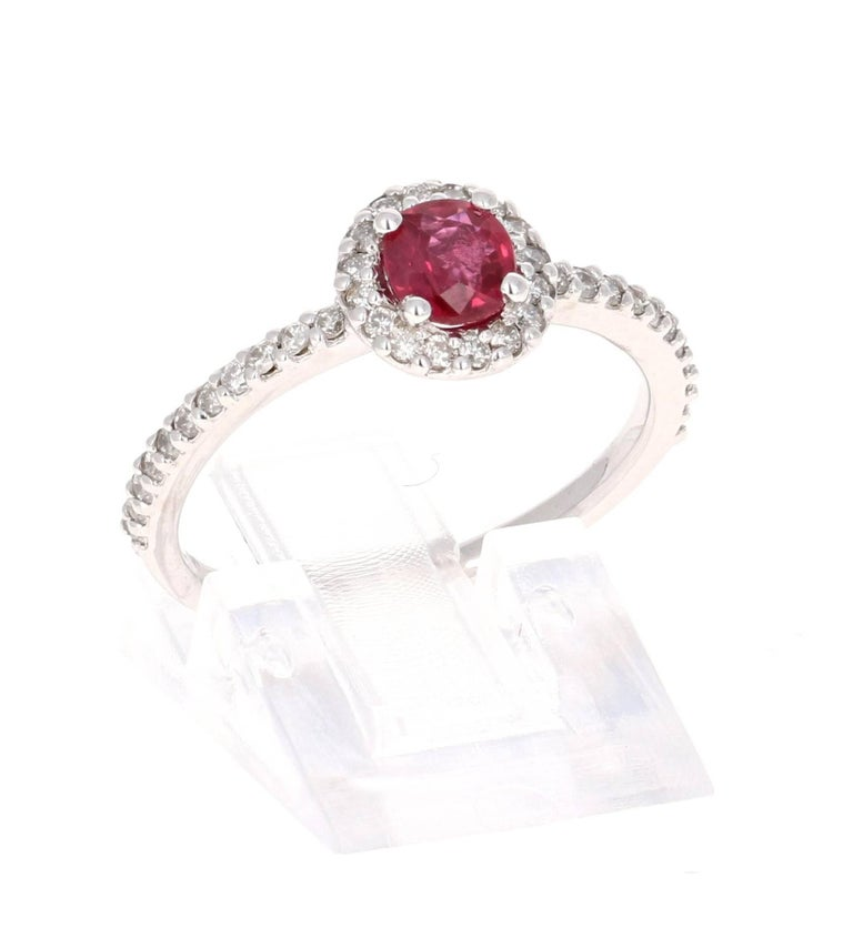 This elegant and dainty Ruby Diamond Ring can be a modern Engagement/Promise ring. It has a natural Burmese Ruby that is 0.60 Carats with a flow of 38 Round Cut Diamonds weighing 0.37 Carats. It is set delicately in 14K White Gold and is a ring size