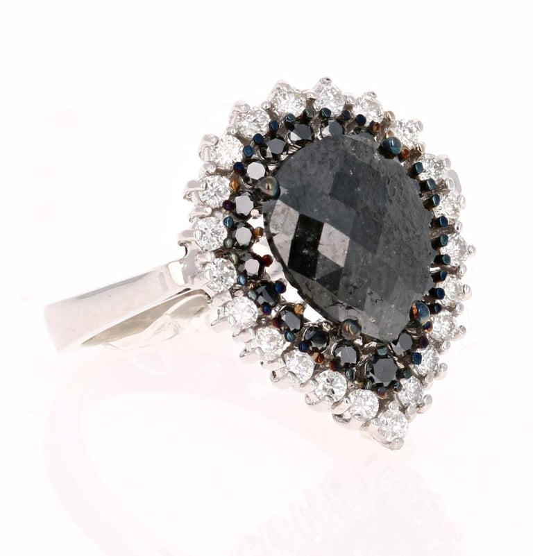 2.61 Carat Pear Cut Black Diamond White Gold Bridal Ring! Gorgeous Black Diamond ring that can transform into an Engagement ring.    There is a 1.91 carat Pear Cut Black Diamond in the center which is surrounded by 20 Round Cut Black Diamonds that