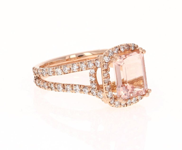 A gorgeous ring that can easily be transformed into an engagement ring for that special someone!  It has a stunning 2.68 carat Emerald cut Morganite set in the center of the ring and has a halo of 92 Round Cut Diamonds that weigh 1.26 carats.  The