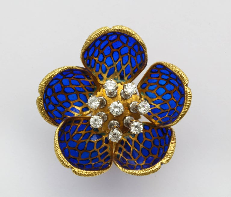 Plique-a-jour enamel flower earclips featuring round brilliant diamond set 'en tremblant.' Each petal of the flower moves, allowing the flowers to appear more open or closed tightly, depending on the wearer's preference. Total diamond estimated