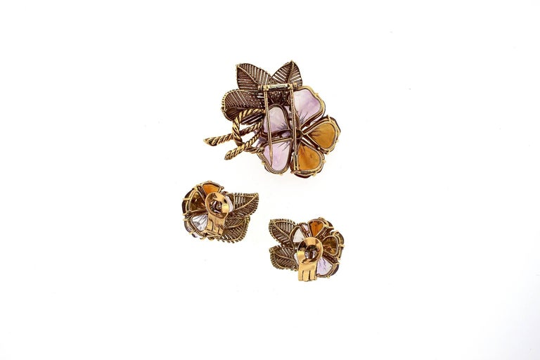 A polished mid-Century set of flower jewelry by Boucheron.  The petals are carved pieces of amethyst and citrine, set with a spray of diamonds.  The 18k gold twisted gold work is a classic Boucheron trademark and makes up the dimension of the