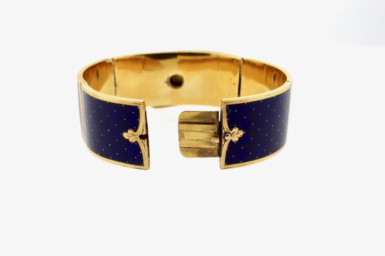 This brilliant blue guilloché enamel bracelet is a work of art. Guilloché comes from the French verb meaning