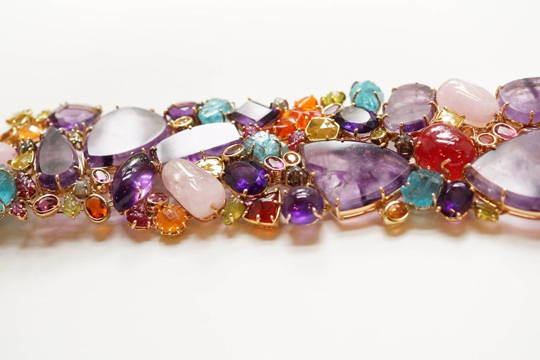Pandora Bracelet A large bracelet composed of a mélange of natural gemstones and diamonds, living side-by-side in chaotic harmony.  The largest gems in this piece, which define the structure, are flat slices of natural amethyst.  They have been