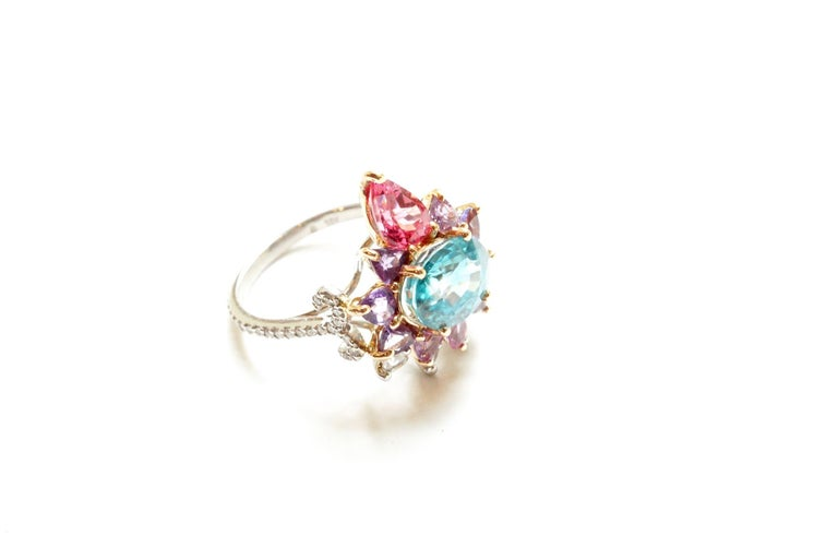Arnez Ring A 3.84 carat ovular blue zircon, set with an entourage of pink and purple sapphire trillions and one large pear-shaped Tanzanian spinel.  Around this surround is a smaller group of pear-shape rose-cut diamonds.  The shank has been