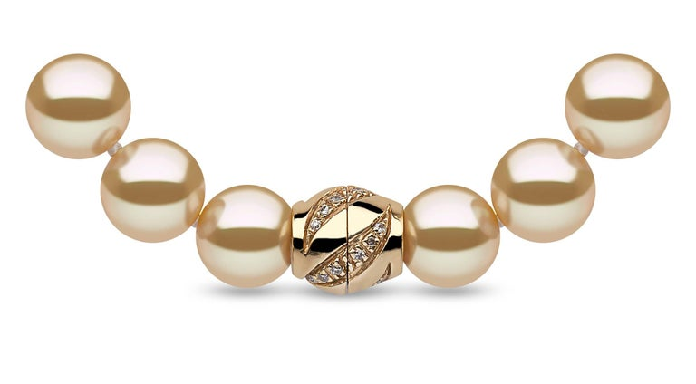 A beautiful Classic Row Necklace of high quality Indonesian Golden South Sea Pearls, strung onto silk and secured to an 18 Karat Yellow Gold Diamond set Ball Clasp.  The intrinsic luxury of Golden South Sea Pearls is apparent from the rich colour