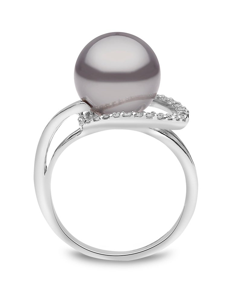 This contemporary ring by Yoko London features a lustrous 10-10.5mm Tahitian pearl and the centre of its design. A trim of diamonds and 18 Karat White Gold Setting accentuate the spectacular colour of the pearl superbly. The subtle design means it