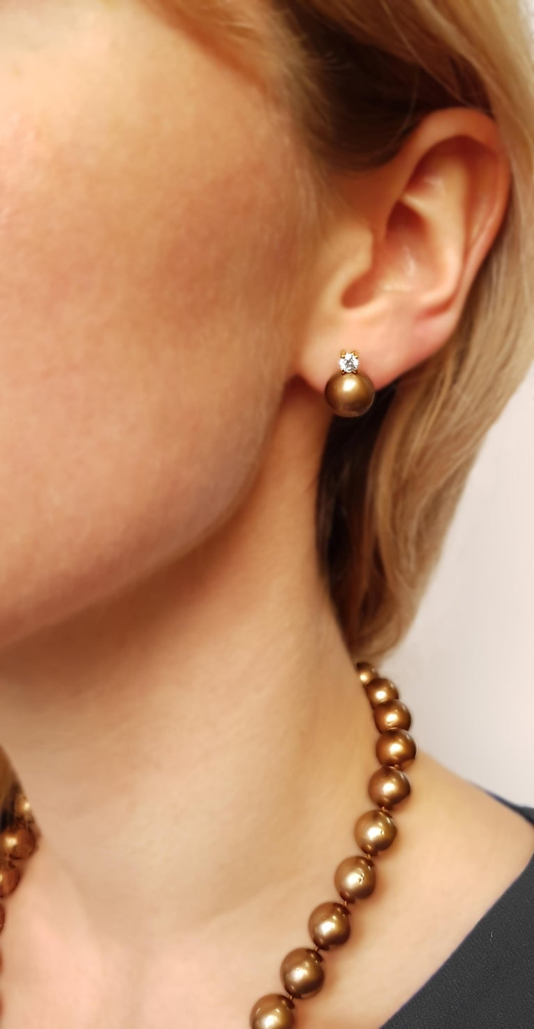 These remarkable earrings from Yoko London feature Chocolate-coloured Tahitian pearls, offering a unique twist to an otherwise classic design. Set in 18 Karat Yellow Gold to enrich the rich, sumptuous colour of the pearls and enhance the bright
