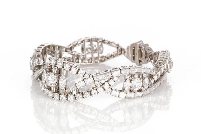 Oscar Heyman Vintage Art Deco Platinum & Diamond Ribbon Bracelet. It features an estimated 22.00ctw F-G/VS-SI Round Brilliant, Baguette, and Marquise Cut Diamonds. They are all securely set in this stunning platinum bracelet. The bracelet will