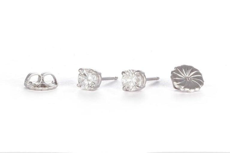 Round Cut Ladies 14 Karat White Gold and Diamond Stud Earrings 1.44 Carat For Sale