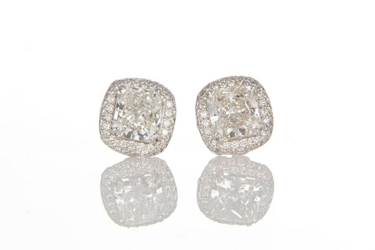 Ladies Michael Beaudry Platinum & Diamond Halo Stud Earrings. These beautiful earrings feature 5.20ctw Radiant & Round Brilliant Cut Diamonds set in .950 Platinum Halo Setting. The center stones are both 2.04ct I/VVS Radiant cut Diamonds set