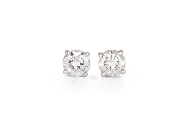 We are pleased to present these Ladies 14K White Gold & Diamond Stud Earrings. These beautiful earrings feature 1.44ctw H-I/SI2-I1 Round Brilliant Cut Diamonds set in 14k White Gold studs with slide back setting. The earrings are brand new unworn.