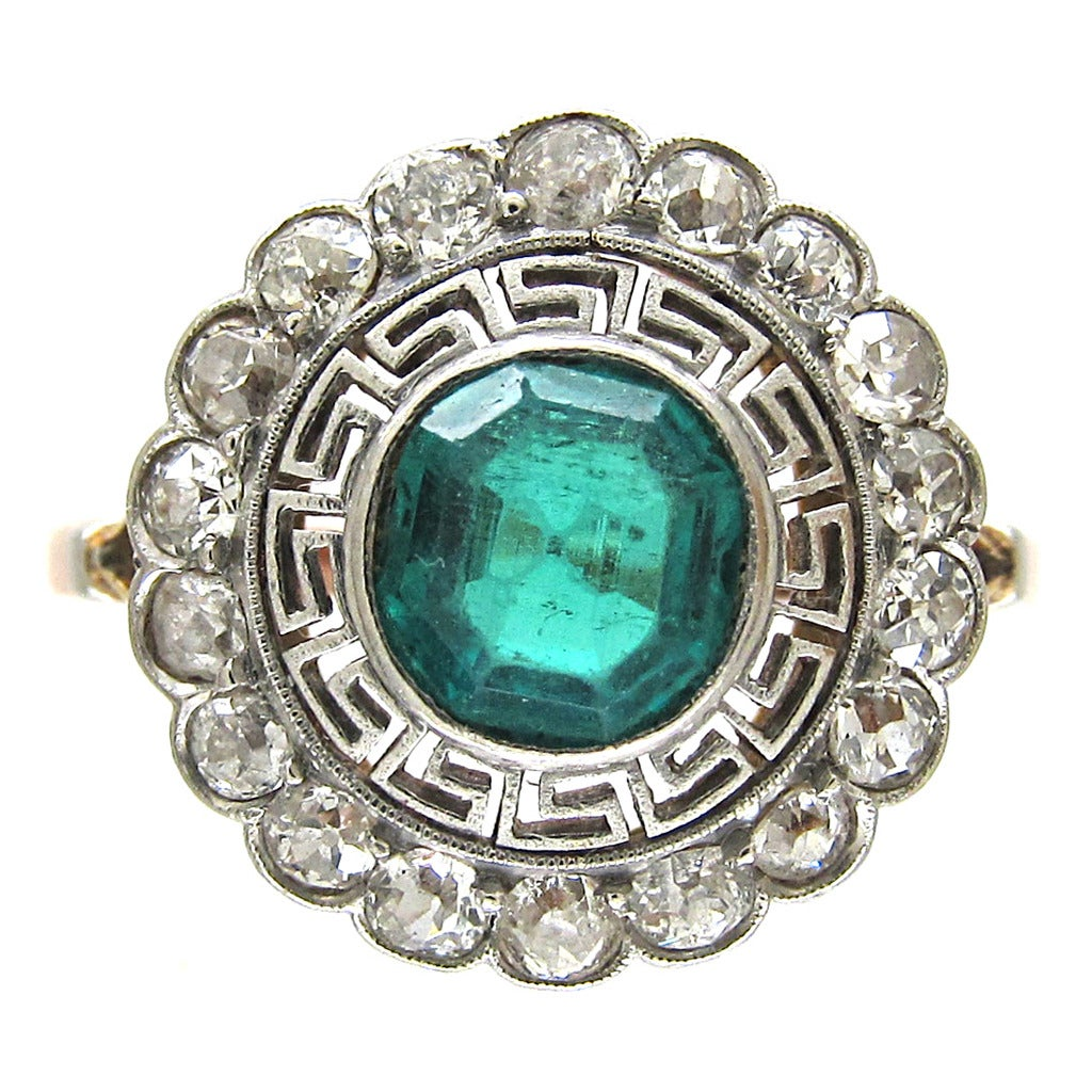 deco emerald target ring with key design