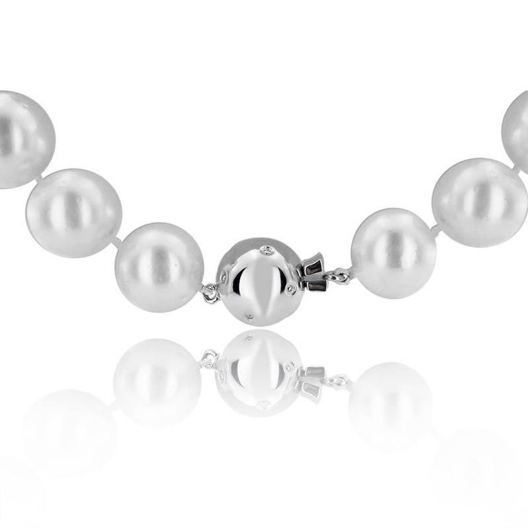 SOUTH SEA PEARL NECKLACE WITH DIAMONDS  18K White gold   Diamonds are situated on the clasp of the necklace, totalling 0.18 ct   Pearl size ; 12-14 mm   Total necklace weight: 106.10 grams