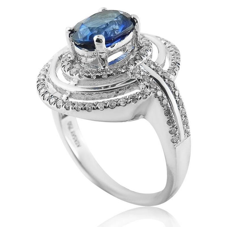 WHITE GOLD OVAL RING WITH OVAL CUT SAPPHIRE AND BRILLIANT CUT DIAMONDS  18K White Gold   Total sapphire weight : 1.73 ct   Total diamond weight: 0.49 ct Color: G-H Clarity: VS-SI  Total ring weight: 5.83 grams