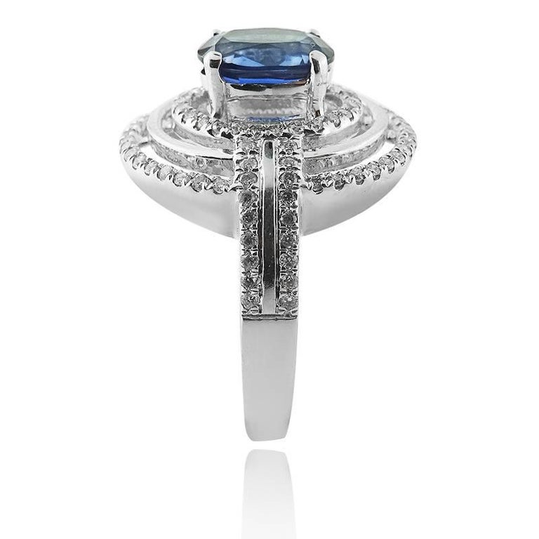 Modern White Gold Oval with Oval Cut Sapphire and Brilliant Cut Diamonds Ring For Sale