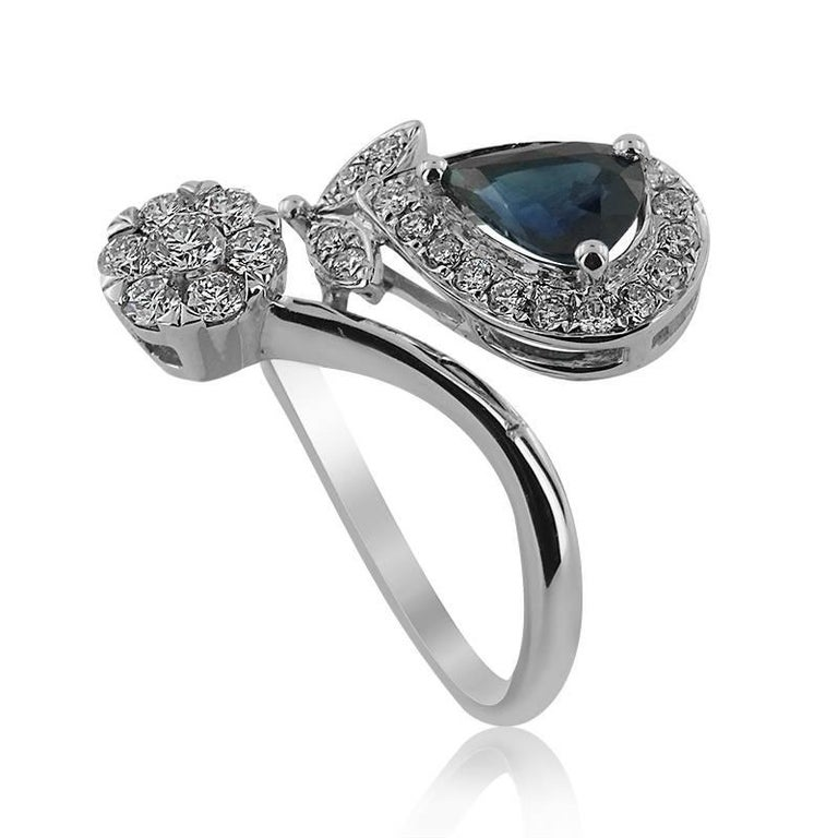 WHITE GOLD RING WITH PEAR SHAPED SAPPHIRE AND BRILLIANT CUT DIAMONDS  Set in 18KT Gold   Pear Cut Sapphire Carat: 0.82   Brilliant Cut Diamonds Carat: 0.40 Color: G-H Clarity: VS-SI   Weight: 3.29 gr