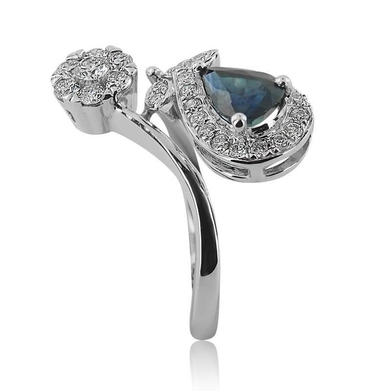Modern White Gold with Pear Shaped Sapphire and Brilliant Cut Diamonds Ring For Sale