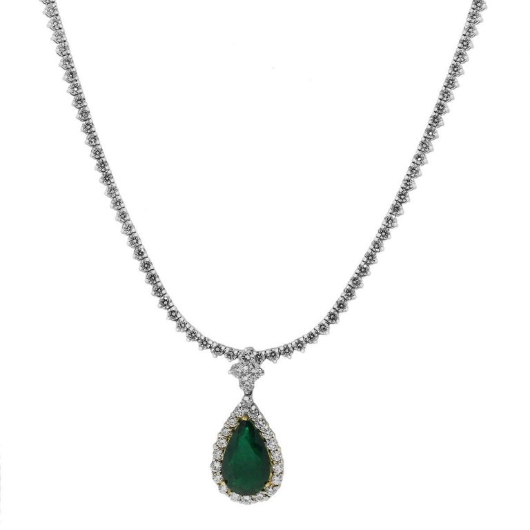 Material: 18k white gold Diamond Details: Approximately 15.75ctw of round brilliant diamonds. Diamonds on the necklace are G/H in color and VS in clarity. Diamonds on the pendant are H/I in color and SI in clarity. Gemstone Details: Approximately