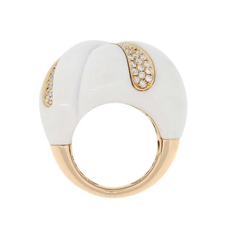 Material: 18k rose gold Diamond Details: Approximately 0.50ctw of round brilliant diamonds. Diamonds are H/I in color and SI in clarity Gemstone Details: Carved white agate Ring Size: 7 Ring Measurements: 1.25″ x 1.12″ x 1.12″ Total Weight: 27g