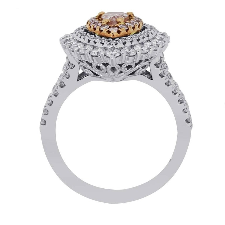 Material: 18k white gold and rose gold Center Diamond Details: GIA certified 0.47ct pear shape fancy pink diamond, GIA certified with cert #2115813908 Other Diamond Details: Approximately 0.18ctw of round brilliant pink diamonds and approximately