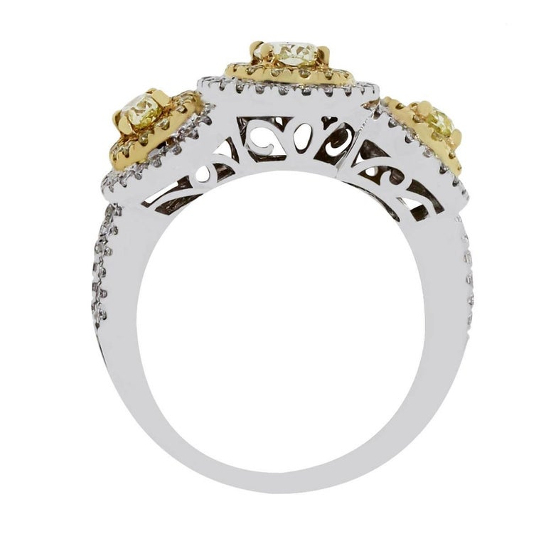 Oval Cut Fancy Yellow and White Diamond Three-Stone Halo Ring For Sale