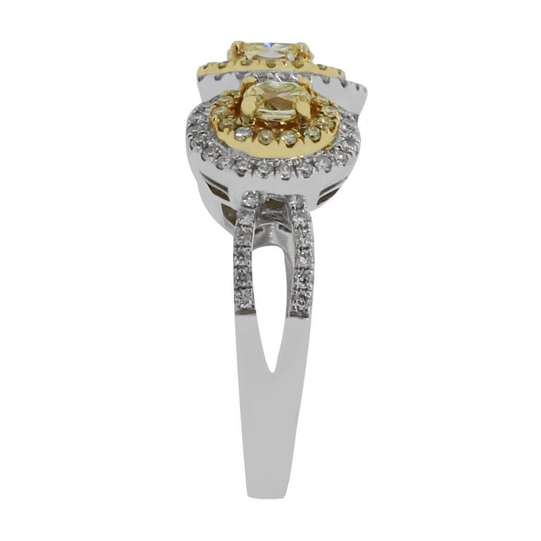 Material: 18k two tone gold Diamond Details: Approximately 1.03ctw yellow diamonds and approximately 0.44ctw white diamonds. Diamonds are G/H in color and VS in clarity. Size: 7 Total Weight: 7.6g (4.9dwt) Measurements: 0.80″ x 0.45″ x 1.10″ SKU: