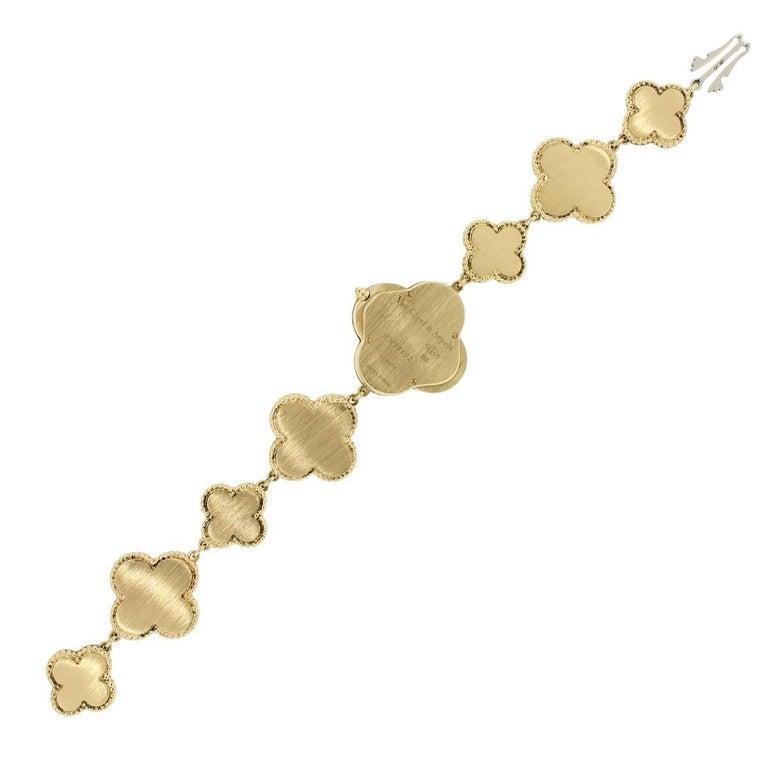 Van Cleef & Arpels Yellow Gold Onyx Alhambra Quartz Wristwatch In Excellent Condition For Sale In Boca Raton, FL
