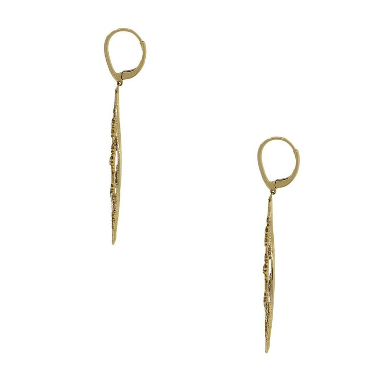 Style: Dangle earrings Material: 18k yellow gold Diamond Details: Approximately 1.84ctw warm champagne diamonds. The diamonds on these earrings are G/H in color and VS in clarity. Earring Measurements: 2.50″ x 0.10″ x 0.95″ Fastening: Lever