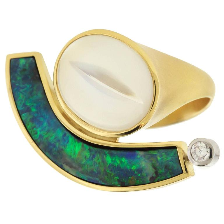 Boulder Opal Moonstone gold Ring by Tom Munsteiner