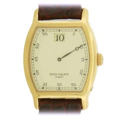 Patek Philippe Rose Gold Tonneau-Shape Anniversary Jump Hour Wristwatch