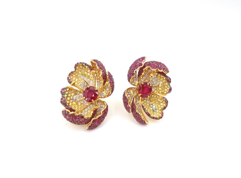 Amazing Red Ruby, Yellow Sapphire and Diamond Flower Earrings with Water Drop in 18K Gold  Height : approx. 3.5-3.7mm  Ruby : 2 pcs 5.34cts. Diamond : 1.41cts. Ruby : 4.95cts. Yellow Sapphire : 3.15cts. Aquamarine : 0.52cts. Gold : 18K Yellow Gold