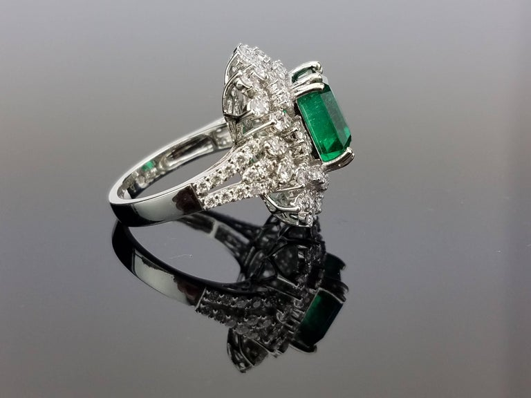 Modern White Gold Zambian Emerald Ring with Diamond Cocktail Ring For Sale