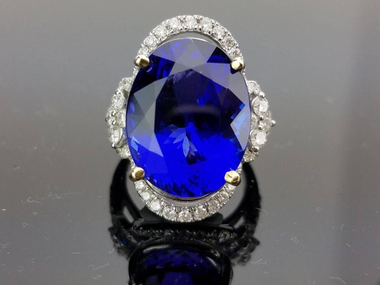 ring split shank diamond tanzanite oval top and