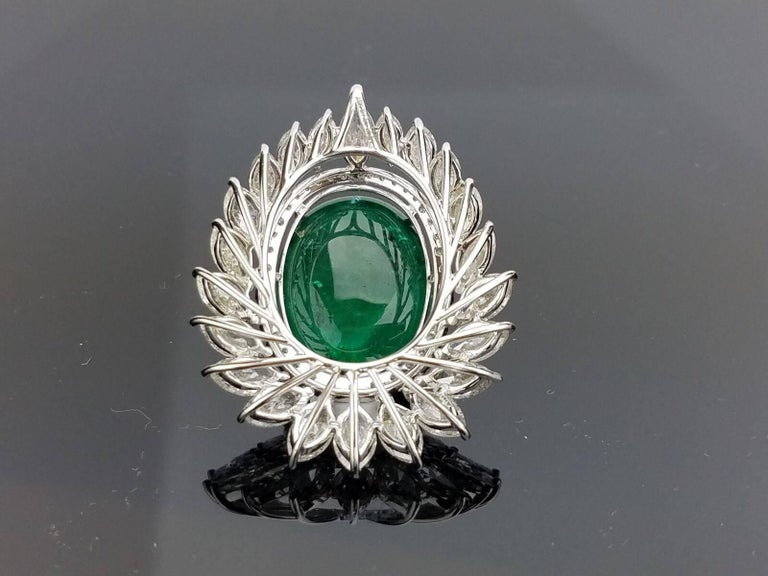 Stone Details:  Stone: Zambian Emerald Cut: Oval, Cabochon Carat Weight: 5.61 Carat  Diamond Details: Cut: Marquise + Brilliant cut Total Carat Weight: 7.27 + 0.59 carat Quality: VS/SI , I/J  18K Gold: 11.73 grams   We can sell the stones / setting