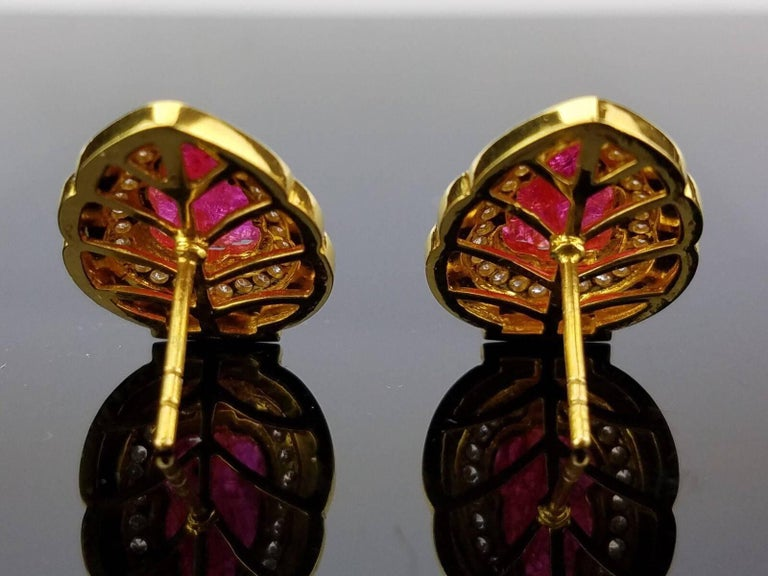 Art Deco 5.23 Carat Carved Ruby and White Enamel Stud Earrings For Sale