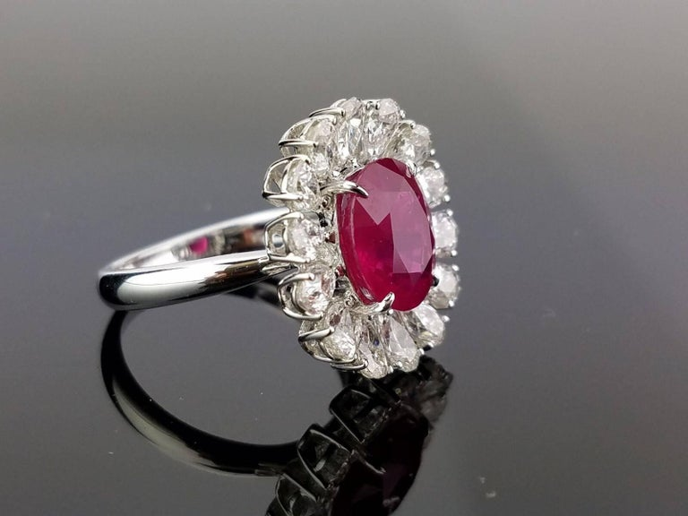 A beautiful oval Burmese Ruby and pear-shaped White Diamond cocktail ring, all set 18K white gold.   Stone Details:  Stone: Burma Ruby Carat Weight: 4.10 Carat  Diamond Details: Shape: Pear Total Carat Weight: 2.54 carat  18K Gold: 5.32 grams