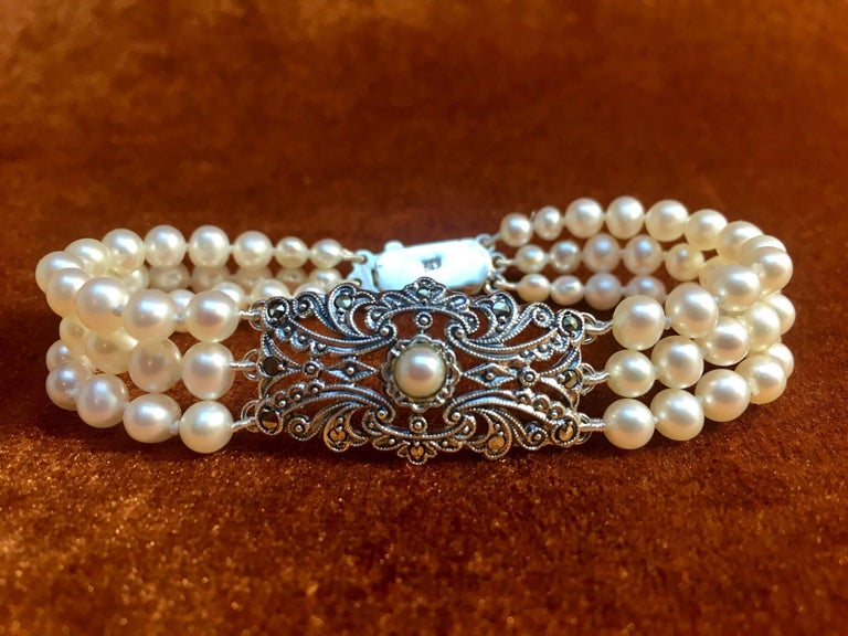 Pearl bracelet made from antique Art Deco brooche ornament set with pearl and marcasites. The original Art Deco brooche ornament has the old original hallmark of Austria. The letter