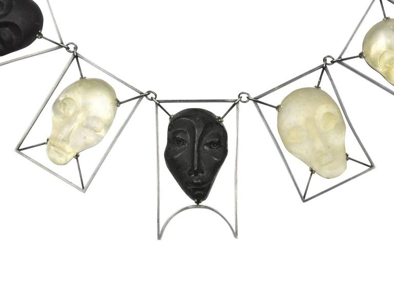BLackened silver necklace featuring frosted and black glas masks. Signed IMRE '96.