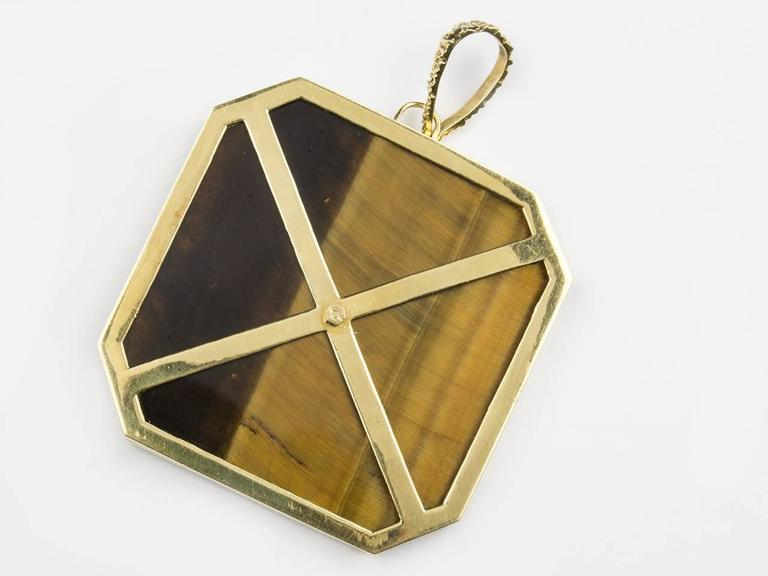 18k gold tiger-eye plaque pendant with engraved Mayan Design