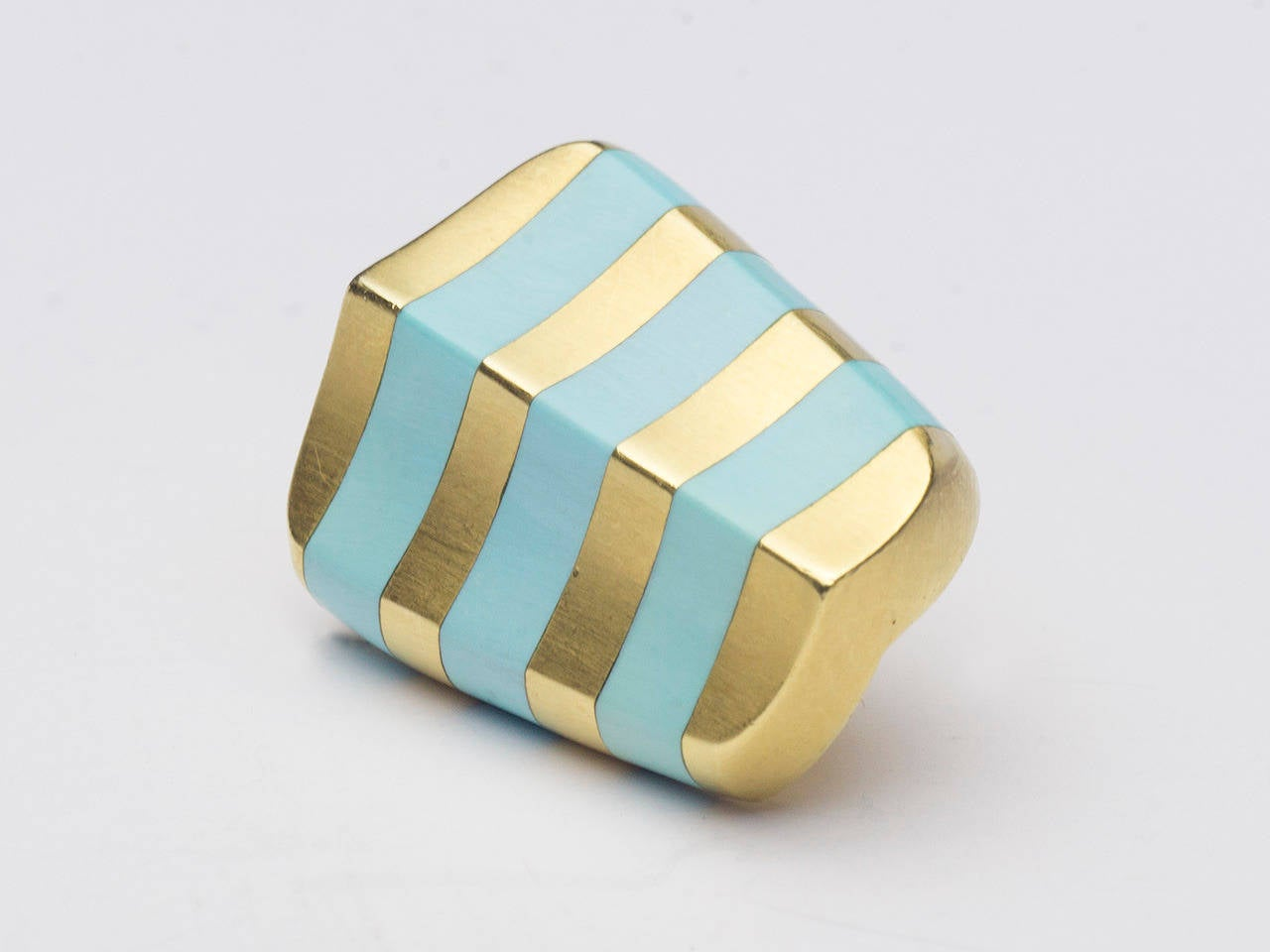 18 kt. earclips set with turquoise in a stripe pattern. Signed ANGELA CUMMINGS 750.
