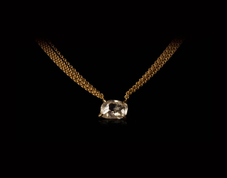 4.19 natural carat rough, uncut diamond in a 14K gold setting suspended from multiple 18 karat gold chains and set in a unique one-of-a-kind necklace.  Every rough diamond from Roughdiamonds dk has been personally handpicked by Maya Bjørnsten right