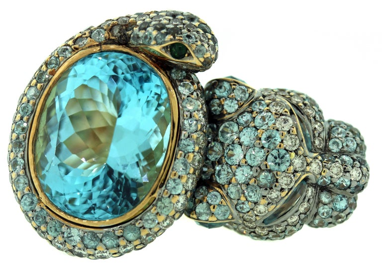 Gorgeous Work of Art by Zorab Creation  18K Gold RIng with Aqumarine, Sapphires and Diamonds    One half of face is done with a stunning oval Aquamarine, apprx. 10ct.  Entire face is done in blue sapphires and diamonds with one half being a tiger